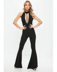Missguided - Black Halter Split Front Kickflare Jumpsuit - Lyst
