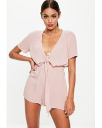 d7a7bb57c4 Missguided - Nude Flutter Sleeve Knot Front Playsuit - Lyst