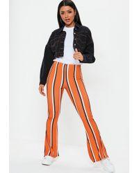 Missguided - Orange Stripe Flare Pants - Lyst