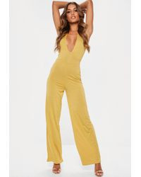 Missguided - Gold Slinky Plunge Wide Leg Jumpsuit - Lyst