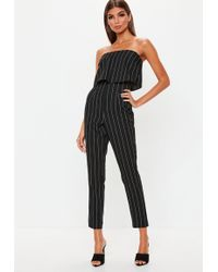 fb563bc1408e Lyst - Missguided Black Lace Up Sleeve Bardot Jumpsuit in Black