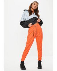 Missguided - Neon Orange Jersey Joggers - Lyst