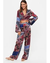 Missguided - Burgundy Navy Floral Print Wide Leg Satin Pants - Lyst