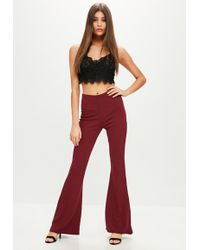 Missguided - Burgundy Jersey Kick Flare Trousers - Lyst