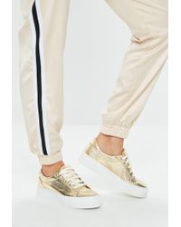 Missguided - Gold Cracked Metallic Flatform Trainers - Lyst
