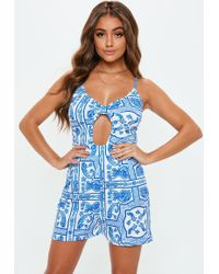 2aea812f18d5 Black Multiway Ribbed Pinafore Jumpsuit.  33. Missguided · Missguided -  Blue Printed Cut Out Playsuit - Lyst