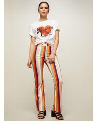 Miss Selfridge - Petite Rainbow Kick Flared Trousers - Lyst