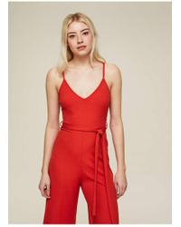 dd33619a951 Miss Selfridge Petite Ochre Ribbed Tie Front Jumpsuit in Yellow - Lyst