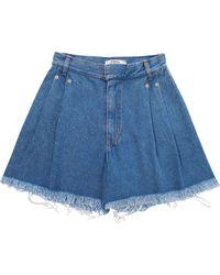 Ksenia Schnaider - Medium Wash Frayed Denim Shorts - Lyst