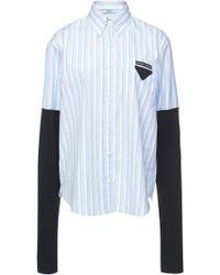 Prada - Paneled Jersey And Striped Cotton-poplin Shirt - Lyst