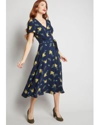 Collectif - Glowing Hostess Floral Wrap Dress - Lyst