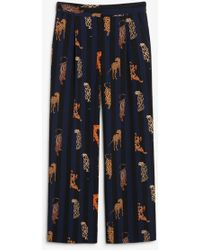 Monki - Stripe Wide Leg Trousers With Leopard Placements In Navy - Lyst