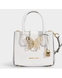 7ea94819dcd81e MICHAEL Michael Kors - Mercer Xs Accordion Tab Messenger Bag In White  Polished Leather - Lyst