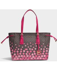 Black tote bag with pierced flowers Coach xelpP