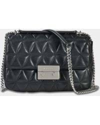 1a583ae2b55d MICHAEL Michael Kors - Sloan Large Chain Shoulder Bag In Black Pyramid  Quilted Lambskin - Lyst