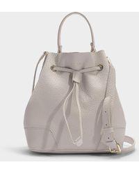 Furla - Stacy Drawstring Small Bucket Bag In Beige Calfskin - Lyst
