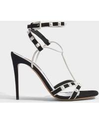 Valentino - Sandales free rockstud en cuir suédé noir et blanc - Lyst