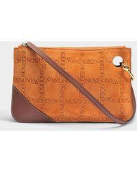 JW Anderson - Logo Pierce Clutch Bag In Burnt Orange Embossed Suede - Lyst