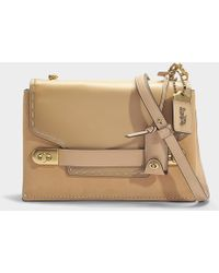 a9afd3dee5 Lyst - COACH Bolsa De Couro Glovetanned Modelo 'swagger 21' in Pink