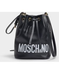 ce1784b088a Moschino - Logo Bucket Bag In Black Leather - Lyst