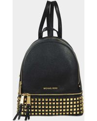 e0431bf5b147 MICHAEL Michael Kors - Rhea Zip Medium Pyramid Studs Backpack In Black  Grained Calfskin - Lyst