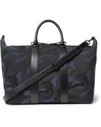2920abb1b4 Mulberry - Leather-trimmed Camouflage-print Canvas Holdall - Lyst