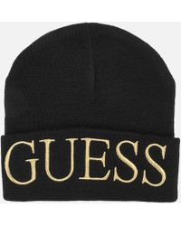 Lyst - Guess Logo Beanie Hat in Black 6e61ee259ff