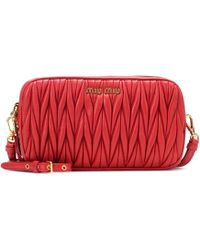 228bcde4429e Lyst - Miu Miu 2 Way Embossed Leather Bag in Red