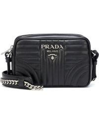 Prada Saffiano Leather Camera Bag in Black - Lyst dfe7fefb10c05