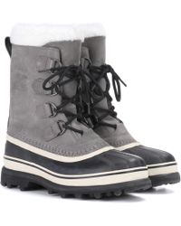 Sorel - Caribou® Leather And Rubber Boots - Lyst