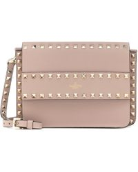 1f292bcd01c Valentino Rockstud Lock Mini Clutch Bag in Purple - Lyst
