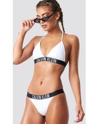 Calvin Klein - Brazilian Bikini Bottom - Lyst