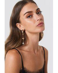 NA-KD - Asymmetric Hanging Globes Earrings - Lyst
