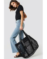 Calvin Klein - Mesh Beach Hold All Bag Black - Lyst