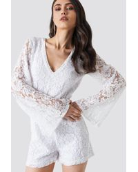 NA-KD - Flared Sleeve Lace Playsuit White - Lyst