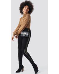 a58b5178b1ff NA-KD - Leopard Side Print High Waist Skinny Jeans Black - Lyst