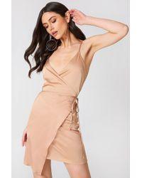 NA-KD - Wrapped Satin Dress - Lyst