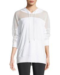 Onzie - Hooded Long-sleeve Mesh Pullover - Lyst