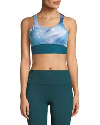 Under Armour - Breathelux Perforated Mid-printed Sports Bra - Lyst