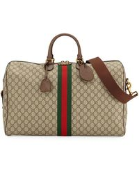 049e60c42ad1 Gucci - Ophidia Leather-trimmed Monogrammed Coated-canvas Holdall - Lyst