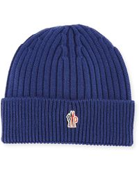 a20d5df06e2 Lyst - Moncler Ribbed Wool Logo Beanie Hat in Blue for Men