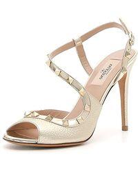 Valentino - Rockstud Asymmetric Metallic Sandal - Lyst
