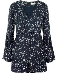 Rebecca Vallance - Flores Wrap-effect Ruffled Printed Crepe Playsuit - Lyst