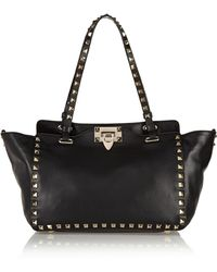 Valentino - The Rockstud Small Leather Trapeze Bag - Lyst