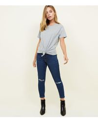 3be8f5c33bd New Look - Petite Navy Ripped Knee Jenna Skinny Jeans - Lyst