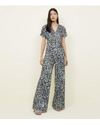 ec29c190a391 New Look Petite Light Grey Check Jersey Jumpsuit in Gray - Lyst