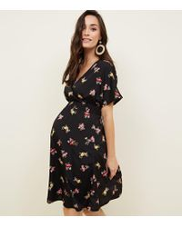 New Look - Maternity Black Floral Shirred Waist Wrap Front Dress - Lyst