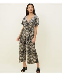 f173e7fcfb4 New Look Brown Leopard Print Velvet Wrap Front Jumpsuit in Brown - Lyst