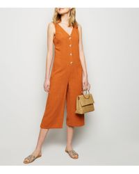 53f07db803 New Look - Rust Linen Look Button Front Crop Jumpsuit - Lyst