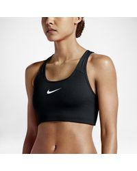 65d7b3646c Lyst - Nike Pro Classic Swoosh Women s Medium Support Sports Bra in Red